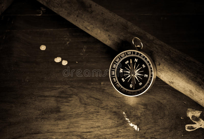 Vintage ancient wooden background with compass. Old wood old compass old background royalty free stock photo
