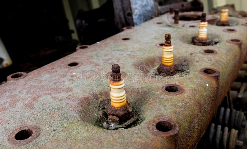 Vintage antique automotive cylinder head with rusty spark plugs royalty free stock images