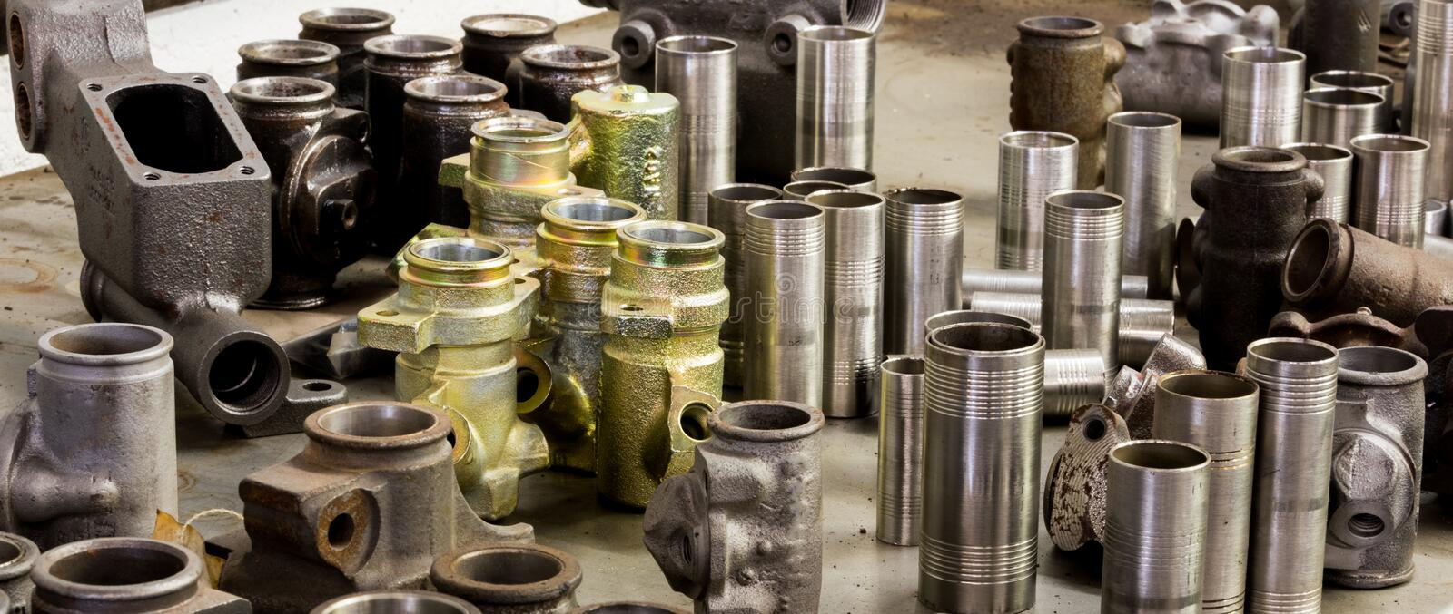 Vintage antique automotive machine shop stainless steel sleeved hydraulic cylinders and tubing. Assortment stock image