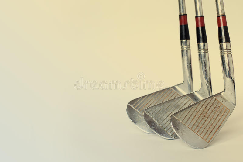 Vintage, antique golf driver (putter) and ball. golf club. retro paper background (toned) royalty free stock photos