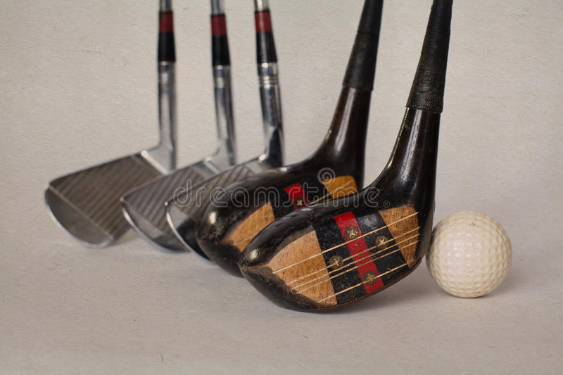 Vintage, antique golf driver (putter). golf clubs on aged textured paper background stock images