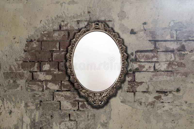 Vintage antique mirror on old brick wall background texture. Space for text stock image