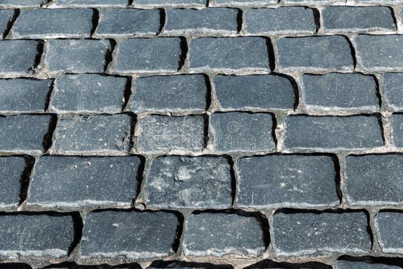 Vintage antique stone pavement. black rectangular stone royalty free stock photos
