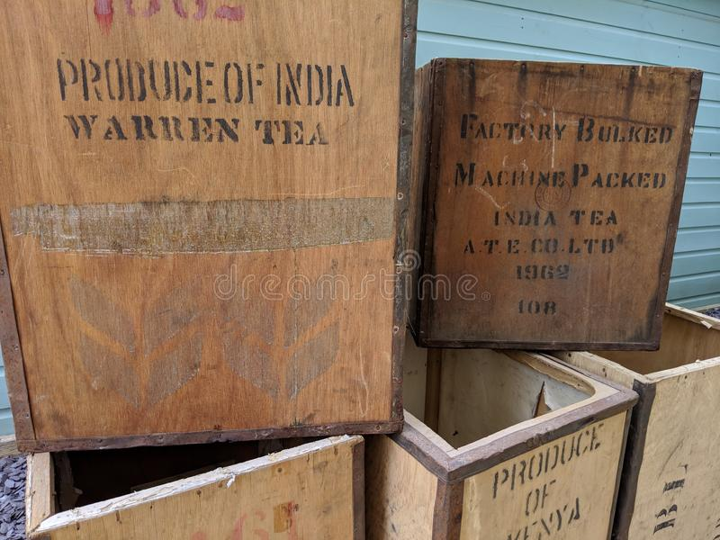 Vintage antique tea chests stacked up royalty free stock images