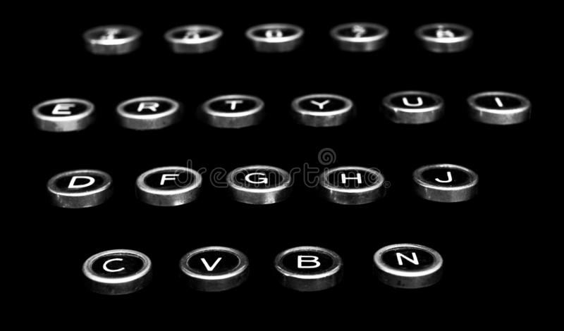 Vintage antique typewriter keys on a black background stock images