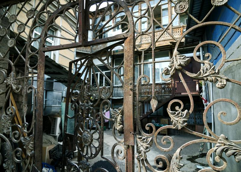 Vintage art wrought iron gate grille royalty free stock images