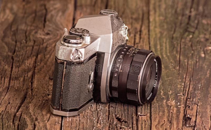 Vintage Asahi Pentax Spotmatic SLR Camera. Side view of a vintage Asahi Pentax Spotmatic SLR camera. The camera dates back to the late 1950`s and used 35mm film royalty free stock photography