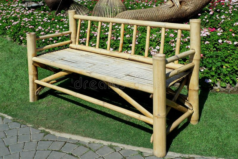 Vintage Asian Bamboo Bench. Isolated Photo of Vintage Asian Bamboo Bench in the City Park royalty free stock photo