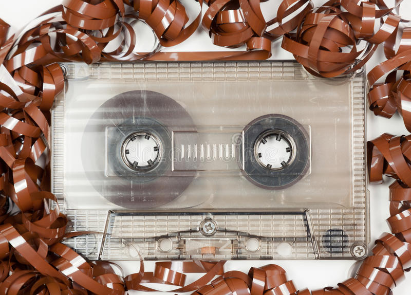 Vintage audio cassette with messed up audio tape stock photography