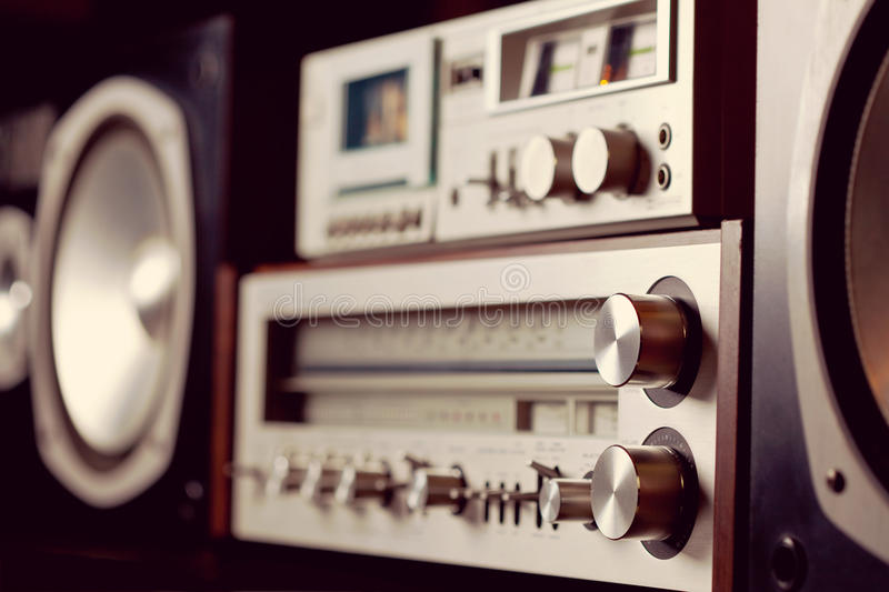 Vintage audio stereo rack with cassette tape deck receiver and s. Peaker, angled view DOF stock image