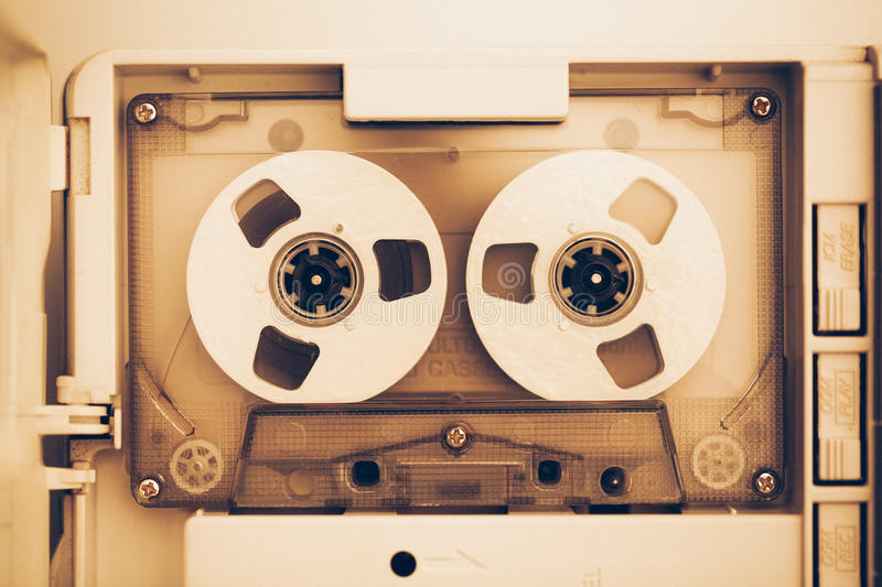 Vintage audio tape compact cassette, sepia tone royalty free stock photo