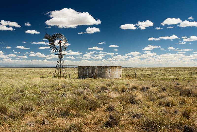 Vintage Australian water pump and concrete tank. stock image