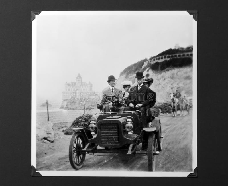 Vintage Auto Photo, Model T Ford with Passengers. Circa 1900 model-T Ford with men in bowler hats (driver is Dr Asa W Collins) and women in backseat. This road