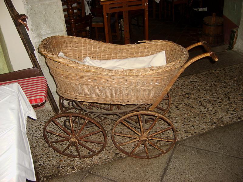 Vintage baby carriage in Gostilna Lectar museum in Radovljica town, Slovenia stock photo