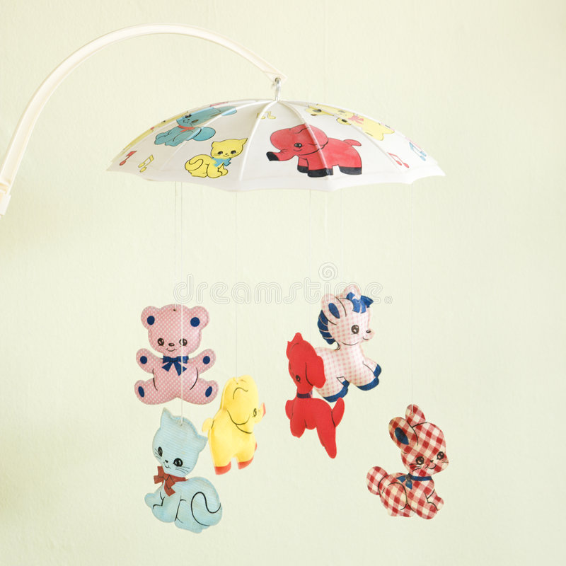 Vintage baby mobile. Still life of vintage baby mobile with colorful moving animals royalty free stock photos