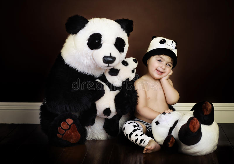 Vintage baby panda. Vintage style photograph with textured wall paper in the background royalty free stock images