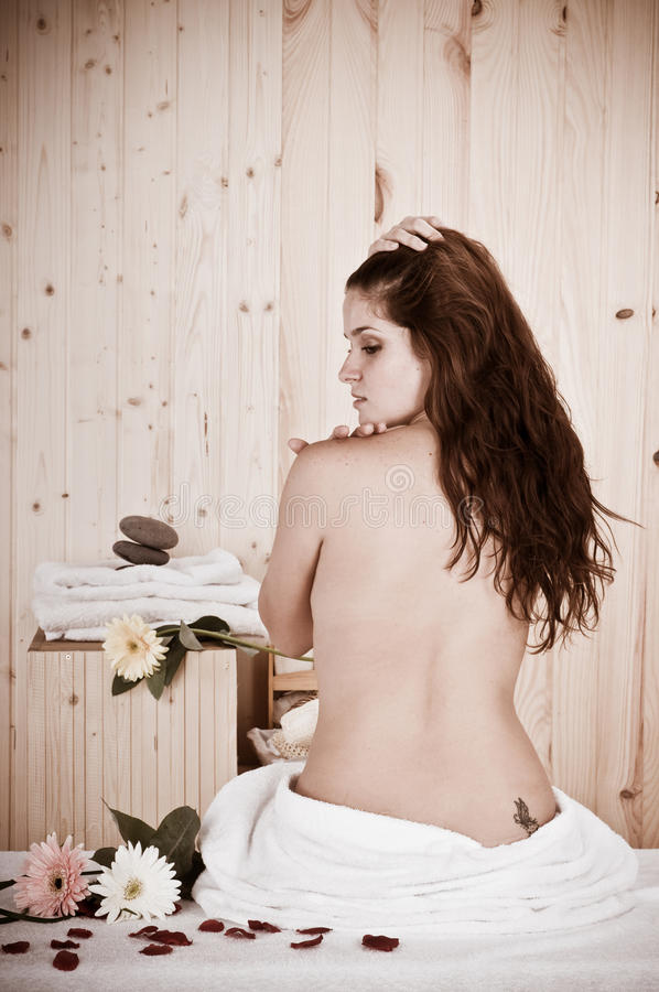Vintage back of a beautiful woman in a sauna or ma stock image