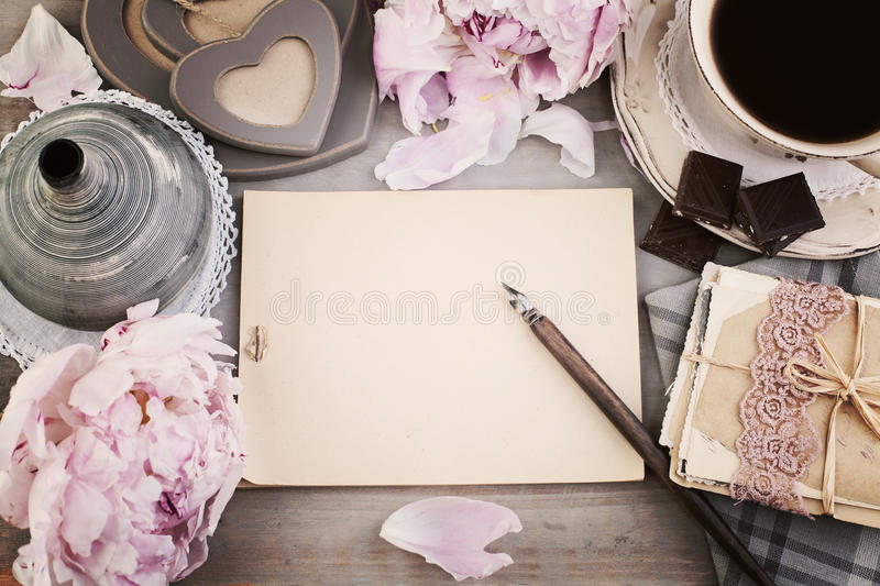Vintage Background with Empty Blank Paper, Old Post Cards. Peony Flowers, Coffee and Chocolates stock photos