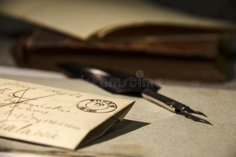 Vintage background. Very old letter and quill pen. stock images