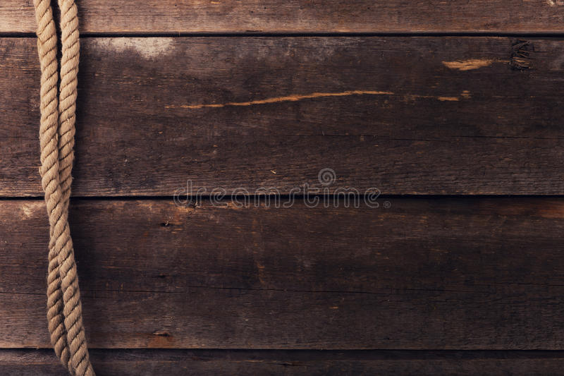 Vintage background with old rope on wood planks royalty free stock image