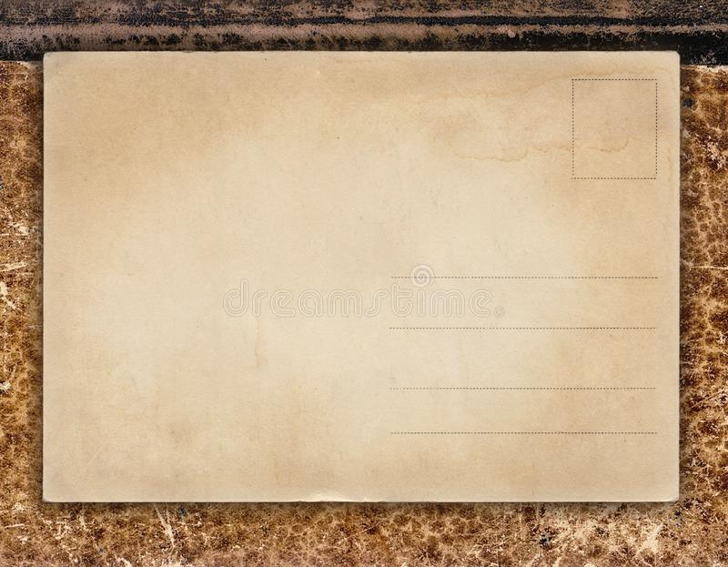 Vintage background with retro postcard on old book cover royalty free stock images
