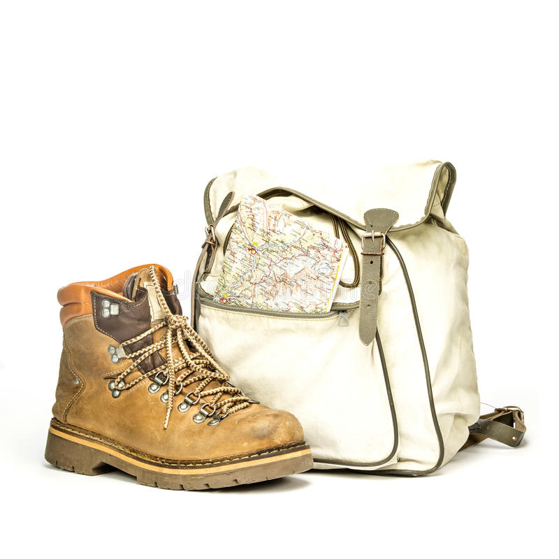 Vintage backpack and hiking boots stock photo