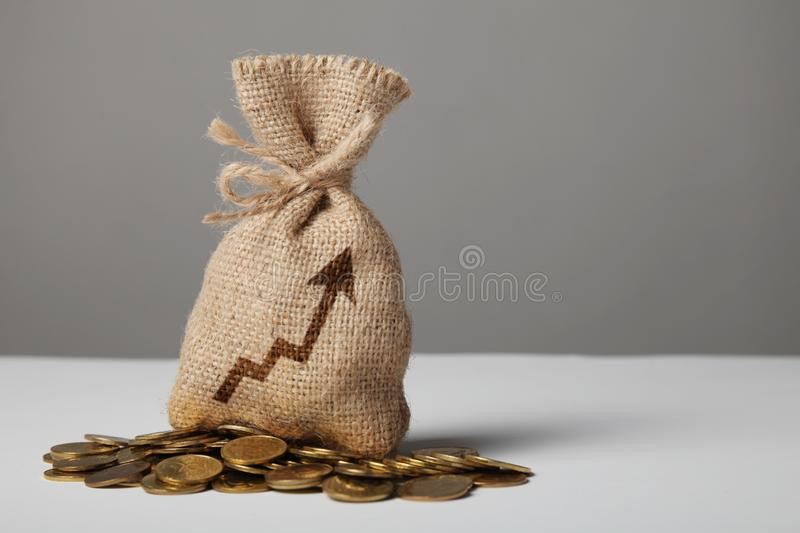 Vintage bag with money on gold coins. Symbol of growth and business success royalty free stock photography
