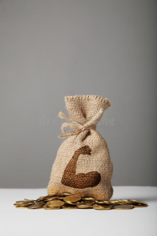 Vintage bag with money on gold coins. Symbol of strength and advantage stock photo