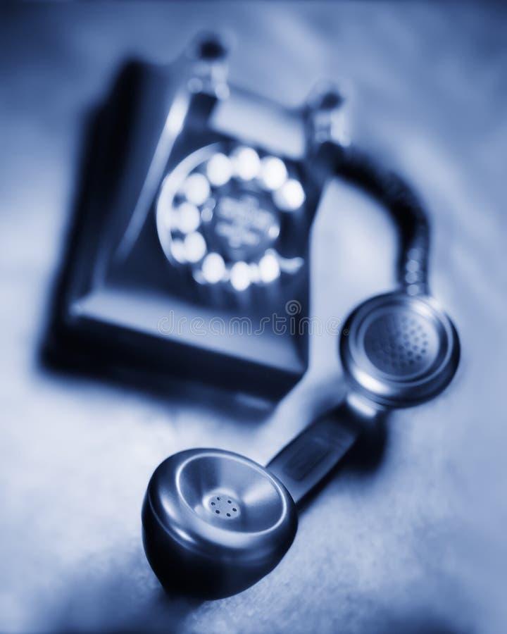 Vintage bakelite dial telephone on rustic metal surface. Selective focus. Old black bakelite dial telephone on rustic metal surface. Selective focus, black and royalty free stock image
