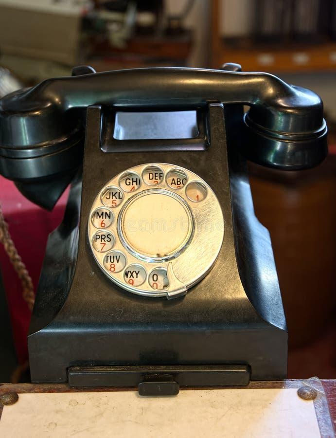 Vintage bakelite dial telephone. Vintage 1950`s rotary dial telephone made from bakelite and had a ringing tone royalty free stock photos