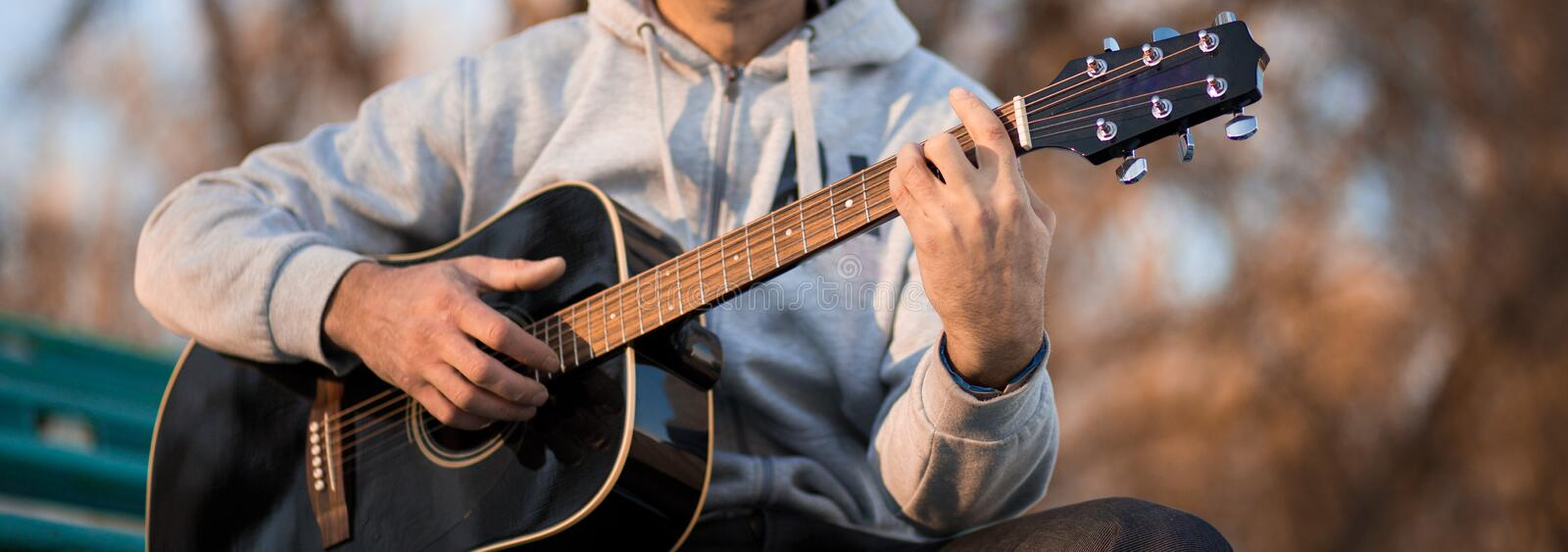 Vintage banner for site header with young man playing guitar stock images