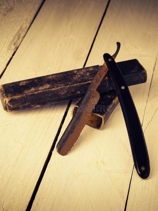 Vintage barber concept with rusty razor. Old and rusty razor on a rustic workbench with space for text or image stock photo