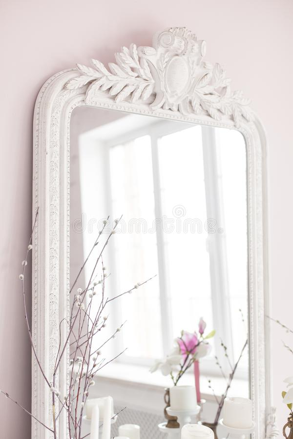 Vintage Baroque mirror with wood carvings in the Royal interior. Close up. Soft focus. stock images