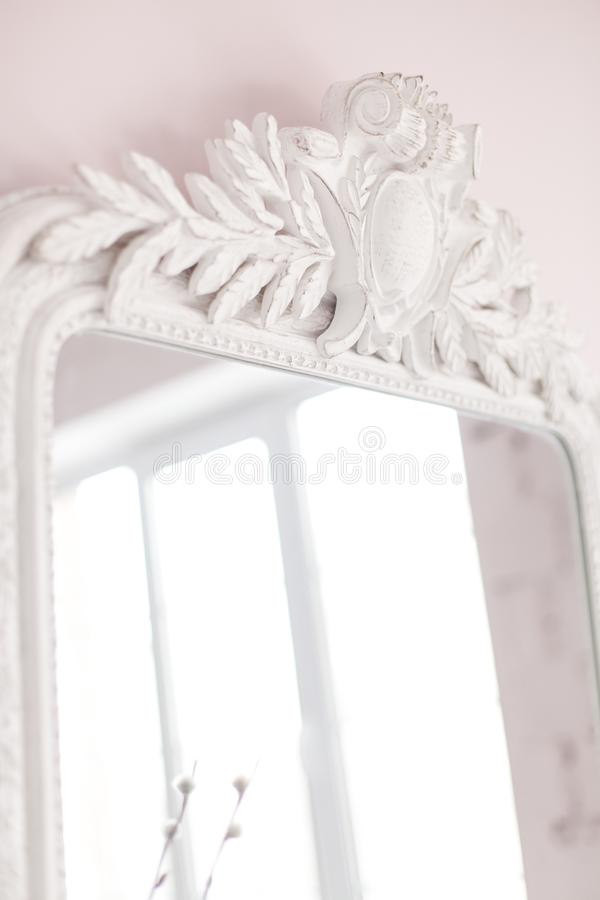 Vintage Baroque mirror with wood carvings in the Royal interior. Close up. Soft focus. stock photo