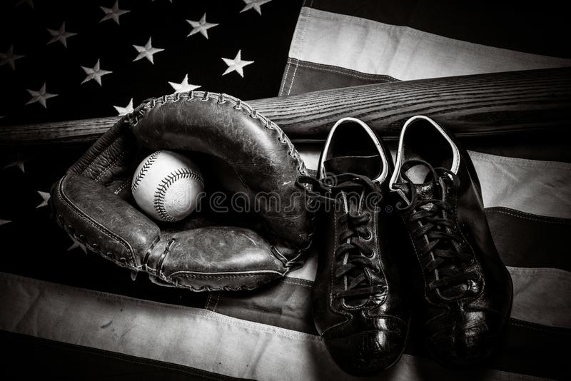 Vintage baseball gear on a American flag background royalty free stock photo