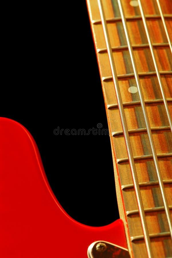Vintage bass guitar. Close-up on black stock photos