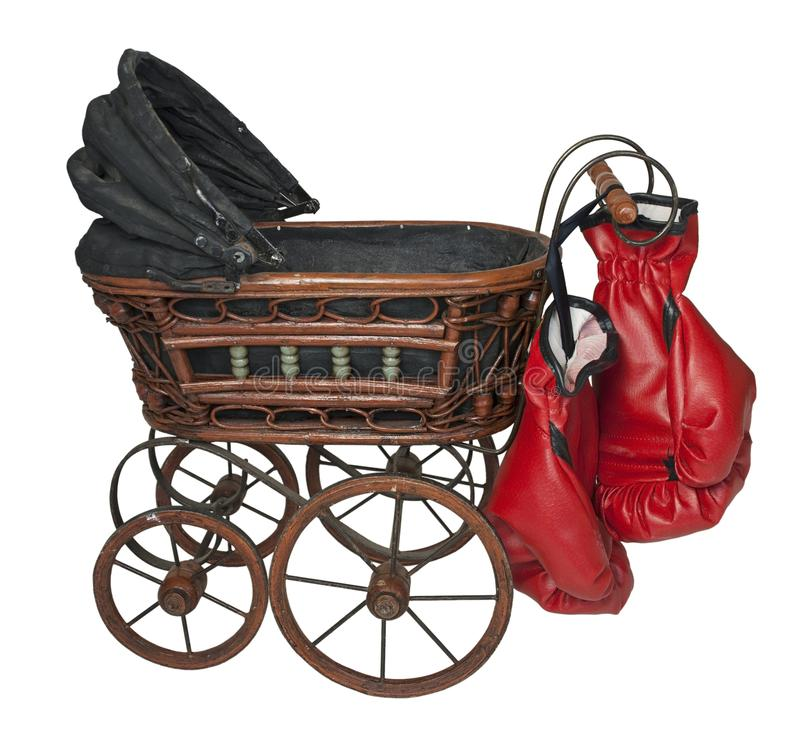 Vintage Bassinet with Boxing Gloves. Showing Child Abuse - path included royalty free stock images