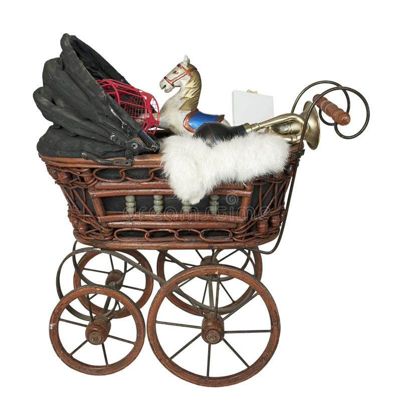 Vintage Bassinet Filled with Antique Toys. Path included royalty free stock photo