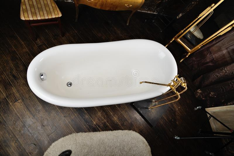 Vintage bath. In the golden dark interior royalty free stock photos