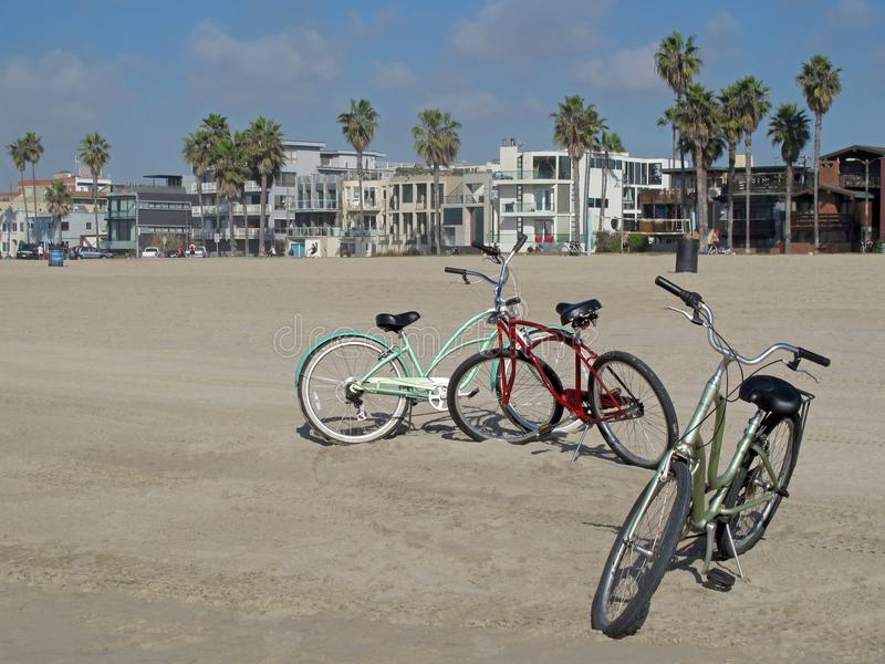 Vintage beach cruiser cycles at beautiful Venice Beach in Los Angeles, California royalty free stock images