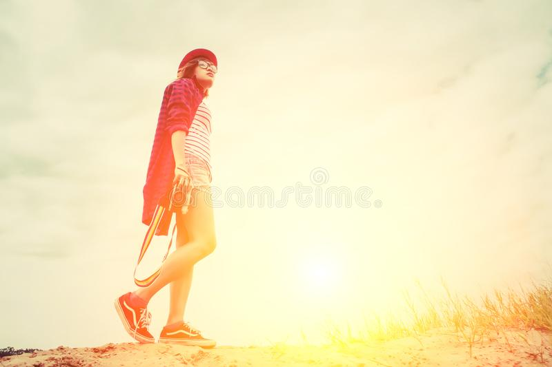 Vintage of beautiful women photography standing hand holding retro camera with sunrise,dream soft style. Vintage of beautiful woman photography standing hand stock image