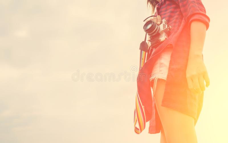Vintage of beautiful women photography standing hand holding retro camera with sunrise,dream soft style. Vintage of beautiful woman photography standing hand stock photography