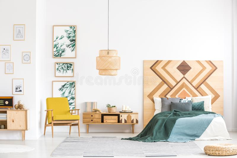 Vintage bedroom interior with wooden accents royalty free stock photography