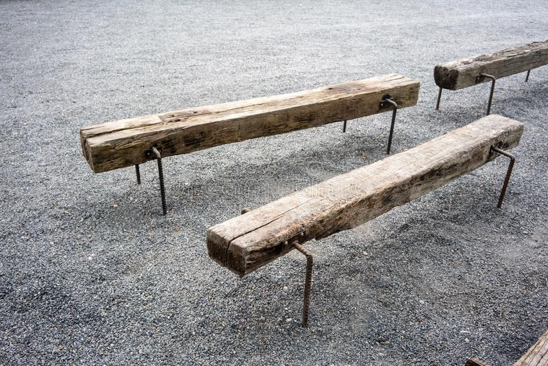Vintage bench made with wood log and metal legs stock photo