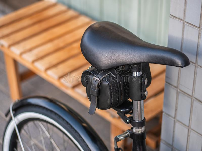Vintage bicycle with black leather seat close up royalty free stock images