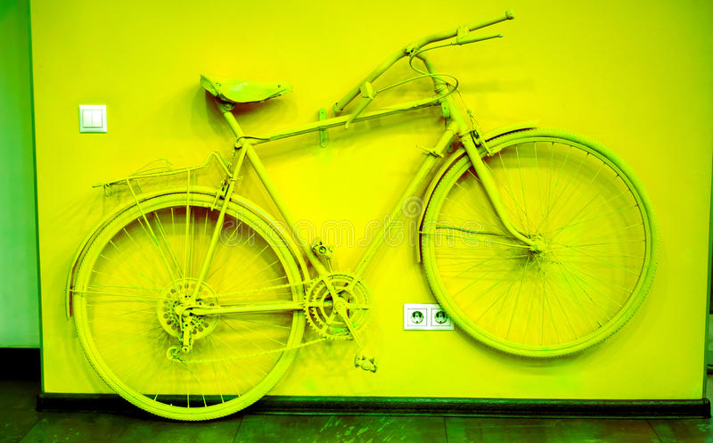 Vintage bicycle on decorative house wall royalty free stock photos