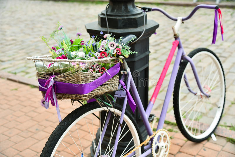 Vintage bicycle with flowers on the trunk stock photography
