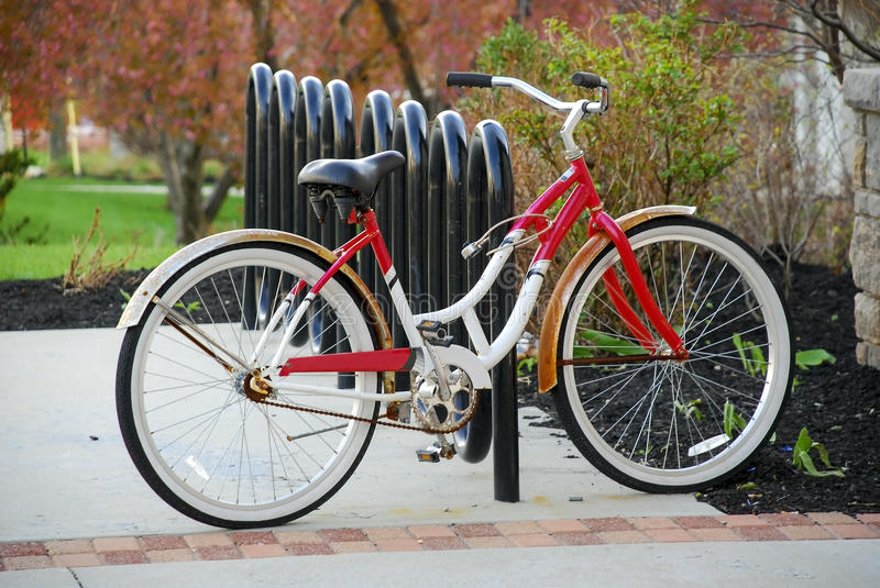 Vintage Bicycle on Modern Bike Rack stock photo