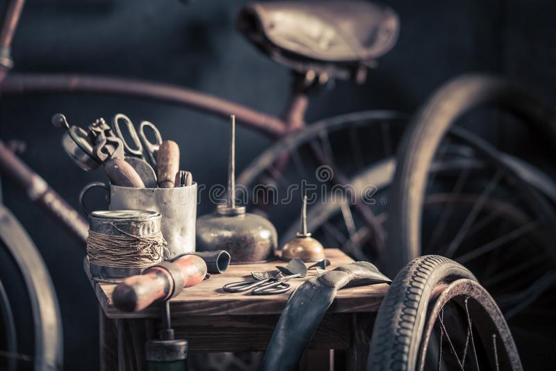 Vintage bicycle repair workshop with pump, rubber patch and glue. On dark background stock photography