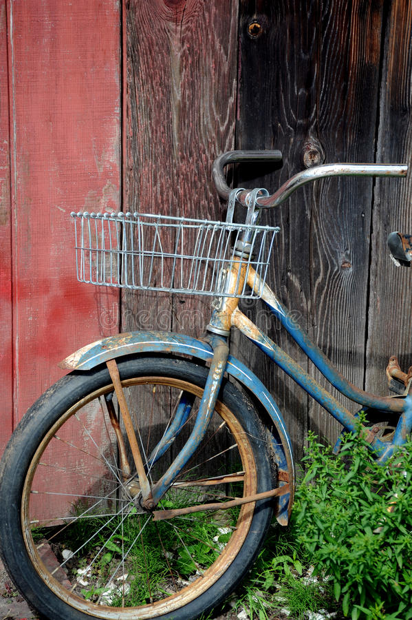 Vintage bike. Vintage rusty bike against a wall outdoors stock photo